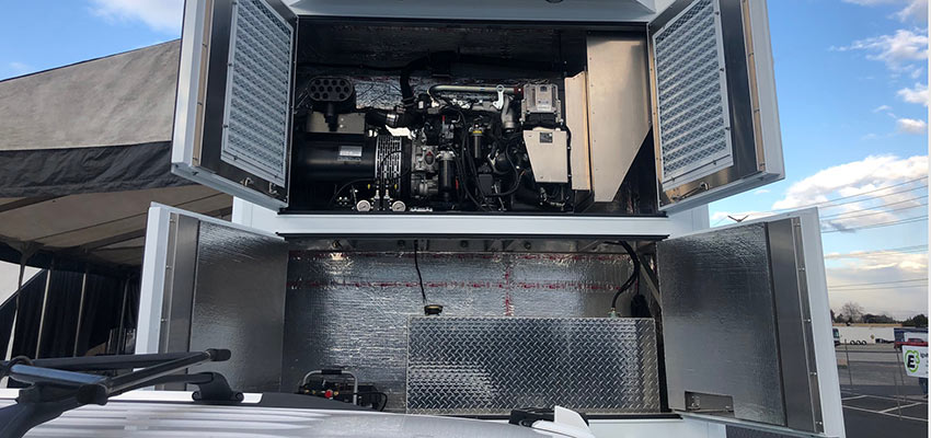 Performer series genset and fuel tank installed in race trailer